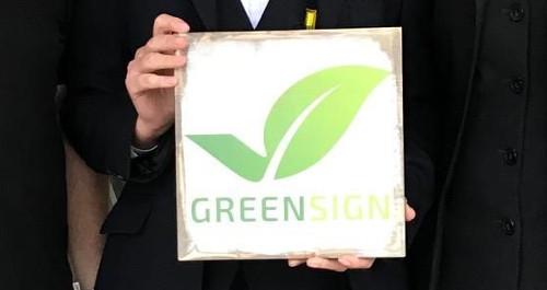 Plakette zum Label Green Sign