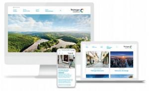 Ein PC, ein Laptop und ein Smartphone mit geöffneter Website von Thüringen entdecken.