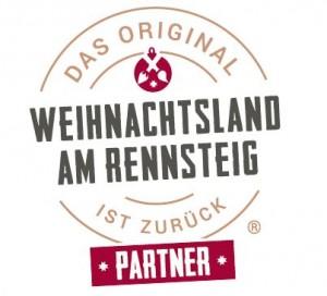 """Kreisrundes Logo mit zweilzeiliger Innenbeschriftung """"Weihnachtslandn am Rennsteig"""" und Beschriftung im umlaufenden Kreis """"Das Original ist zurück"""" mit dem Zusatz """"Partner"""""""