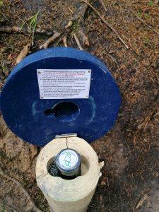Stempelpilz mit Stempel auf dem ein Waldkäuzchen zu sehen ist.